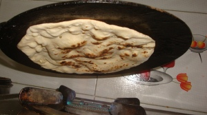 Roti being cooked on the reversed tawa